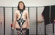 Brunette slut gets tied in bondage
