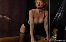 Big tit MILF gets spaned in bondage
