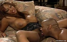 Big tit ebony MILF Dominique Simone takes it deep in the twat