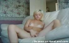 Sexy blonde masturbating on the sofa