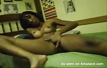 Sexy ebony GF strips and fingers her shaven snatch