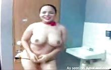 Busty Latina in pink strips in the bathroom