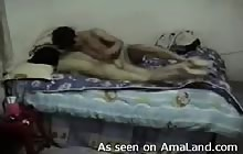 Asian couple's fuck session in bed