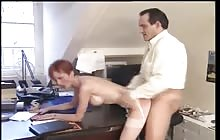 Mature redhead secretary gets her ass fucked in the office