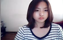 Lovely Korean girl masturbates on webcam