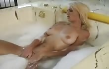 Good looking blonde spies on her neighbours while she is masturbating