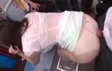 Sexy Japanese babe groped in bus giving out handjob to strangers