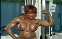 Muscle women showing off their ripped bodies in the gym
