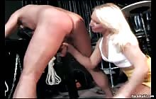 Sexy blonde slut gives handjob to tied guy